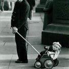 Man and baby in Trafalgar Square London - 8x10 photo