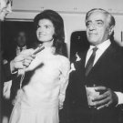 Jacqueline and Aristotle Onassis talking to press reporters. - 8x10 photo