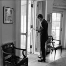John F. Kennedy reading in the oval office. - 8x10 photo
