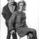 Catherine Deneuve sitting in front of David Bailey. - 8x10 photo