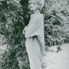 Lisa Fonssagrives striking a pose beside a tree, 1958. - 8x10 photo