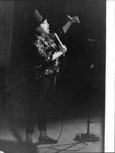 Judy Garland on stage. - 8x10 photo