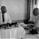 Mahatma Gandhi talking to Vallabbhai Patel, indian home minister. - 8x10 photo