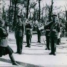 A Red Army woman photographer taking pictures of the Devonshire Band during the