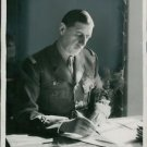 Charles de Gaulle writing at his desk - 8x10 photo
