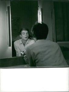 Rudolf Nureyev looking at himself in mirror.  - 8x10 photo