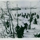 Soldiers running in a snowy field, close to Leningrad 1943. - 8x10 photo
