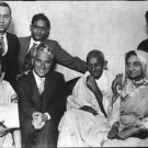 Mahatma Gandhi and Charlie Chaplin sitting with people - 8x10 photo