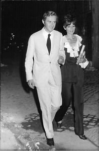Audrey Hepburn wearing a formal suit with Andrea Dotti, walking. - 8x10 photo