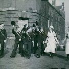 Soldiers giving honor to the cooks (WRNs) on the way to the Field Kitchen. in En