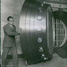 A man opening armored bank vault door. 1929. - 8x10 photo