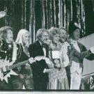 Members of ABBA joyously receiving an award.  - 8x10 photo
