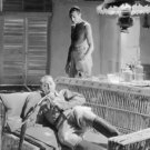 Gary Cooper and a man in a movie scene. - 8x10 photo