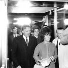 Elizabeth Taylor with her husband Richard Burton surrounded by people.   - 8x10