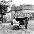 Duke Ellington playing piano in alfresco.  - 8x10 photo