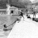 Ludmilla Tcherina enjoying by pool side. - 8x10 photo