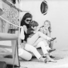 Jacqueline Kennedy Onassis having fun with her children. - 8x10 photo