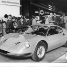 People admiring the Ferrari, parked outside for display. - 8x10 photo