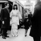 Francois Roland Truffaut with a Japanese actress and her kid. - 8x10 photo