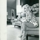 Marilyn Monroe sitting on sofa. - 8x10 photo