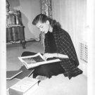 Lauren Bacall reading book.  - 8x10 photo
