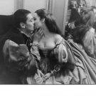 Romy Schneider kissing Alan Delon. - 8x10 photo
