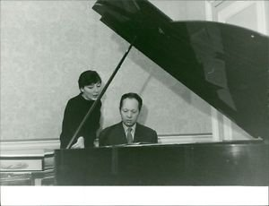 Juliette Greco with pianist at a grand piano.  - 8x10 photo