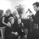 Edith Piaf smiling with friends while posing for photography.  - 8x10 photo