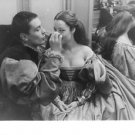 Romy Schneider sitting with Alain Delon, in a costume. - 8x10 photo