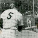 Marliyn Monroe looking a baseball player in net during practice.  - 8x10 photo