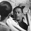 William Holden looking at intense attitude of Audrey Hepburn in movie scene. - 8