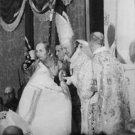 A man kissing on Pope John XXIII's hand. - 8x10 photo