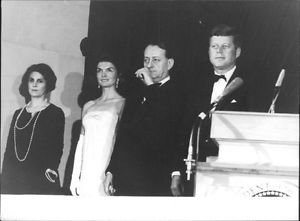 John F. Kennedy and his wife Jacqueline Kennedy with people. - 8x10 photo