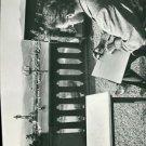 Charlton Heston sitting on balcony and writing.    - 8x10 photo