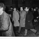 Francois Roland Truffaut talking while walking with friends. - 8x10 photo
