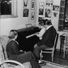 "Johan Jonatan ""Jussi"" Bjorling looking his child playing piano.  - 8x10 photo"