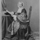 Fredrika Bremer reading book while sitting on chair.  - 8x10 photo