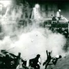 Soldiers using tear gas against protesters in Sorbonne, Paris. - 8x10 photo