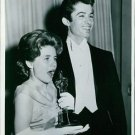 Patty Duke holding her Oscar prize statue and George Chakiris standing beside he