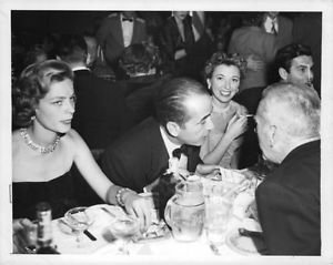 Humphrey Bogart and his wife Lauren Bacall at an event. - 8x10 photo