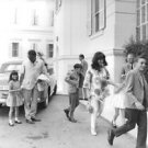 Richard Burton and his wife Elizabeth Taylor holding hand of children. - 8x10 ph