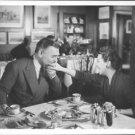Clark Gable kissing on hand. - 8x10 photo