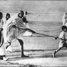 Mahatma Gandhi playing on a beach - 8x10 photo