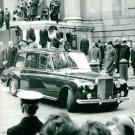 Queen Elizabeth in a car, military man saluting. - 8x10 photo