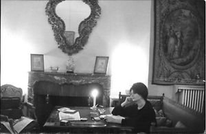 Sophia Loren sitting by candle light. - 8x10 photo