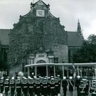 Soldiers standing in a queue in front of church.  a vintage photo from the Prins