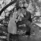 People are doing romance.   people, woman, man, romance, tree, alfresco, smili