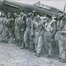 Eag;e SquadronA group of the Eagle squadron pilots on the side on an aircraft,