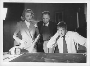 King Vidor, Gary Cooper and Patricia Neal communicating. - 8x10 photo