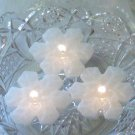 Set of 12 mini glittering snowflake floating candles